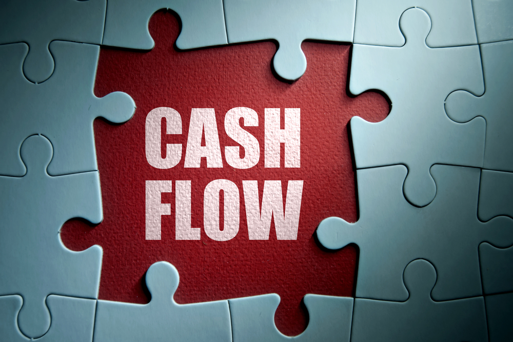 Missing pieces from a jigsaw puzzle revealing cash flow